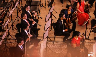 orchestra flutes and violinists