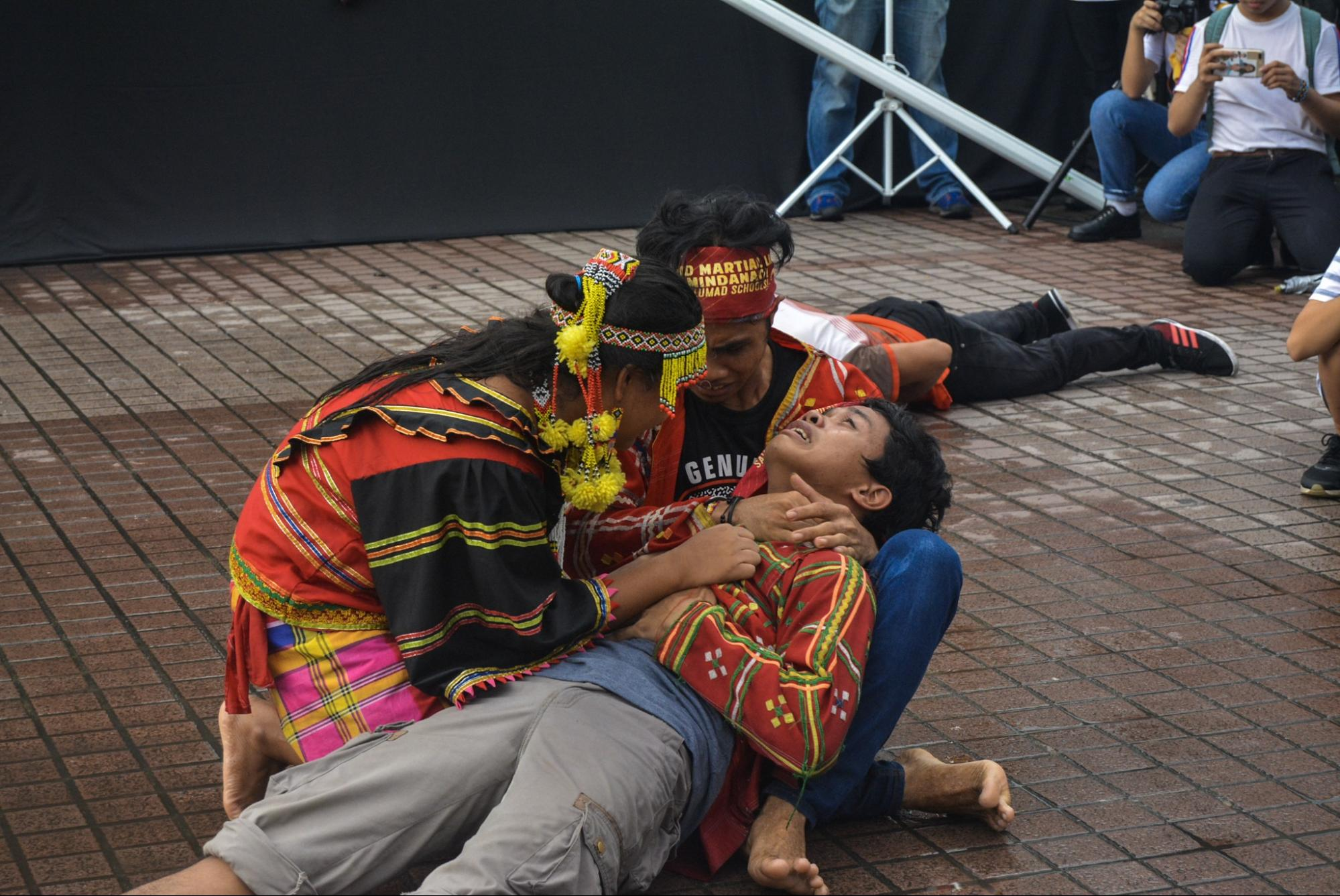 lumads creating a person, shot scene