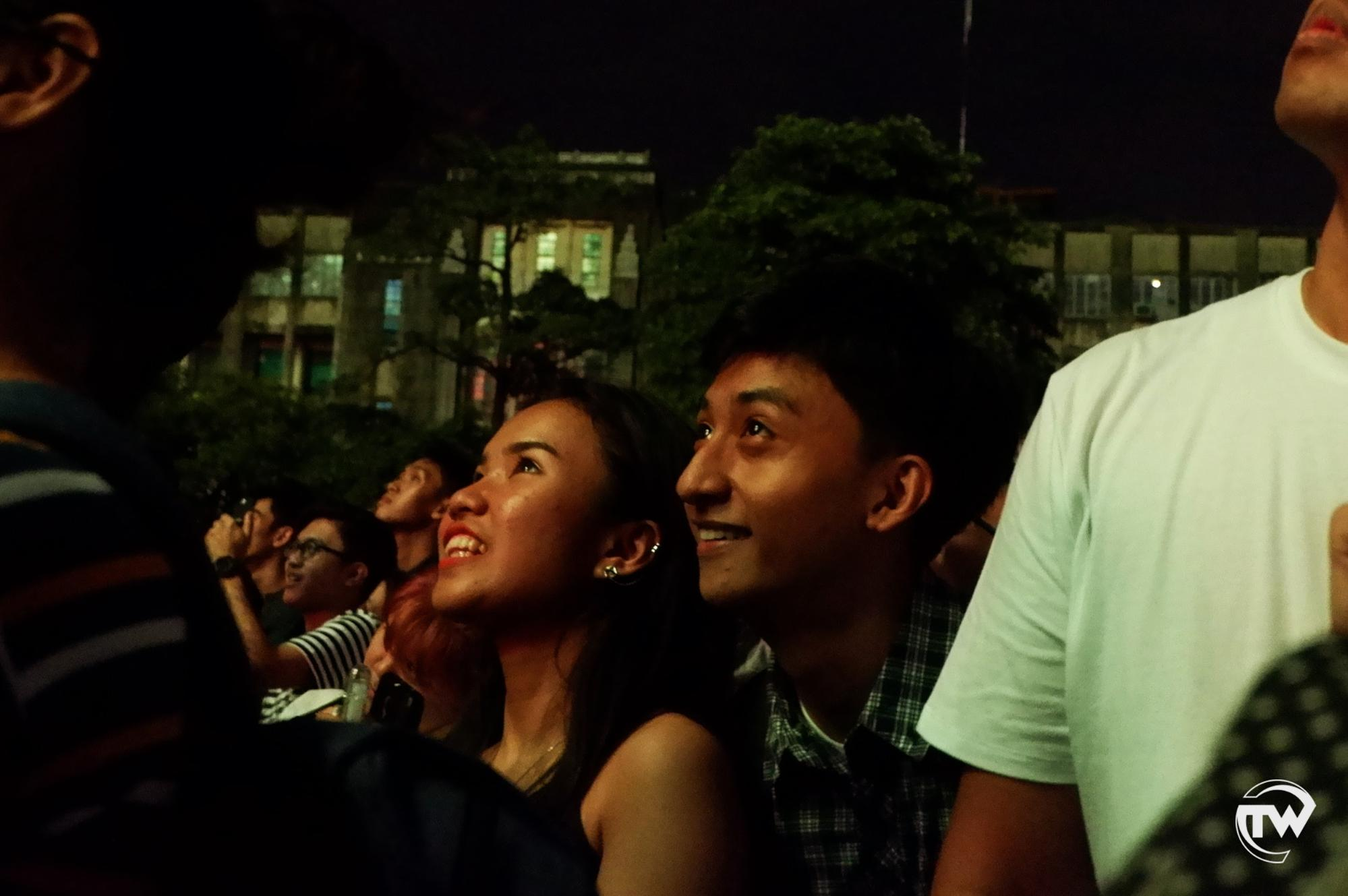 couple looking at the paskuhan fireworks