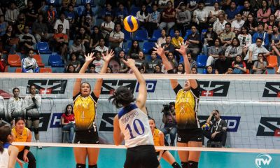 lady eagles spike blocked by golden tigresses